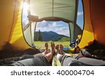 two people lying in  tent with... | Shutterstock . vector #400004704