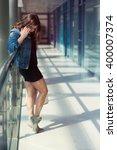 pretty stylish woman walking in ... | Shutterstock . vector #400007374
