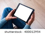 man using tablet computer while ...   Shutterstock . vector #400012954