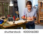 busy woman tinkering in... | Shutterstock . vector #400046080