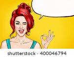 Pop Art Winking Woman Showing...
