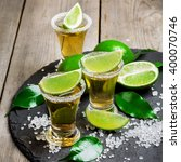 gold mexican tequila shot | Shutterstock . vector #400070746