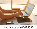 young man working with laptop ... | Shutterstock . vector #400075339