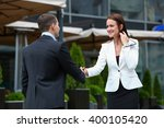 business partners meet on the... | Shutterstock . vector #400105420