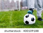 feet of child on football  ... | Shutterstock . vector #400109188