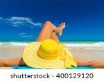 woman in bikini wearing a... | Shutterstock . vector #400129120