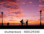 silhouettes of people enjoying... | Shutterstock . vector #400129240