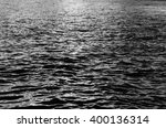 water with waves by day  may be ... | Shutterstock . vector #400136314