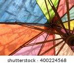 rainbow parasol in garden.... | Shutterstock . vector #400224568