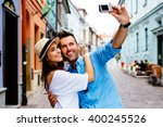 Tourists Couple Taking Selfie...