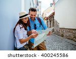 happy couple on vacation... | Shutterstock . vector #400245586