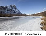 Small photo of Scenic spring view on the fast mountain frozen river. Northern Norway.Troms.