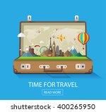 open suitcase with famous... | Shutterstock .eps vector #400265950