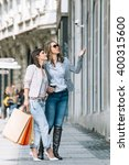 two young women with shopping... | Shutterstock . vector #400315600