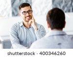 two handsome businessmen in... | Shutterstock . vector #400346260