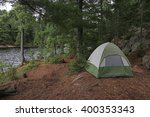 A Green Tent Setup Right Besid...