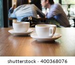 two cups of coffee on the table ... | Shutterstock . vector #400368076