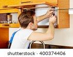 handyman fixing kitchen's... | Shutterstock . vector #400374406