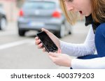 young woman picking up her... | Shutterstock . vector #400379203