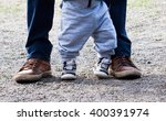 two pairs of legs  child and... | Shutterstock . vector #400391974