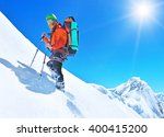 hiker on the trek in himalayas | Shutterstock . vector #400415200