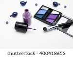 makeup products in purple tone | Shutterstock . vector #400418653
