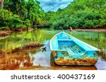 Old Boat In Tropical River ...
