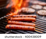 tasty hot dogs cooking on grill ... | Shutterstock . vector #400438009