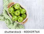 green apples in basket over... | Shutterstock . vector #400439764