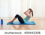 young woman exercising.  sit up ... | Shutterstock . vector #400442308