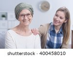 senior smiling woman with scarf ... | Shutterstock . vector #400458010