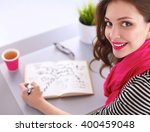 young woman writes to diary on... | Shutterstock . vector #400459048