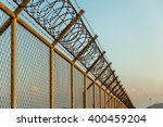 Rusty Barbed Wire Fence In...