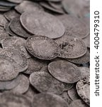 Small photo of trove of ancient medieval coins silver background