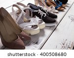 lady's different shoes in row.... | Shutterstock . vector #400508680