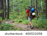 hiker with a backpack goes on a ...   Shutterstock . vector #400521058