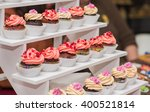 beautiful cupcakes with berries ... | Shutterstock . vector #400521814