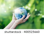 hands holding and protect earth ... | Shutterstock . vector #400525660