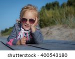 happy smiling little girl on... | Shutterstock . vector #400543180
