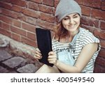 hipster girl sitting at the... | Shutterstock . vector #400549540