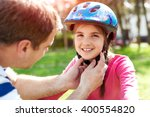 father teaching brave daughter... | Shutterstock . vector #400554820