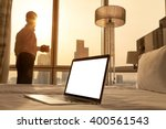Stock photo laptop computer on white bed sheets in cozy room with copy space blank screen young businessman 400561543