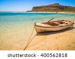 Fishing Boat Docked To Coast O...