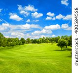 green field and blue cloudy sky.... | Shutterstock . vector #400584538