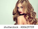 beautiful girl with long wavy... | Shutterstock . vector #400629709