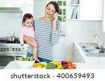 happy woman carrying daughter... | Shutterstock . vector #400659493