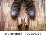 father and son brown shoes on... | Shutterstock . vector #400664389