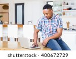 young man sitting on table... | Shutterstock . vector #400672729