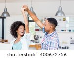 happy couple dancing in kitchen ... | Shutterstock . vector #400672756