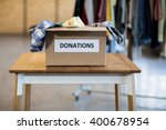 donation box on a wooden table... | Shutterstock . vector #400678954